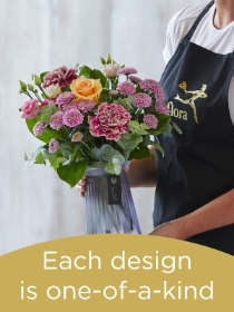 Hand tied bouquet and vase made with seasonal flowers